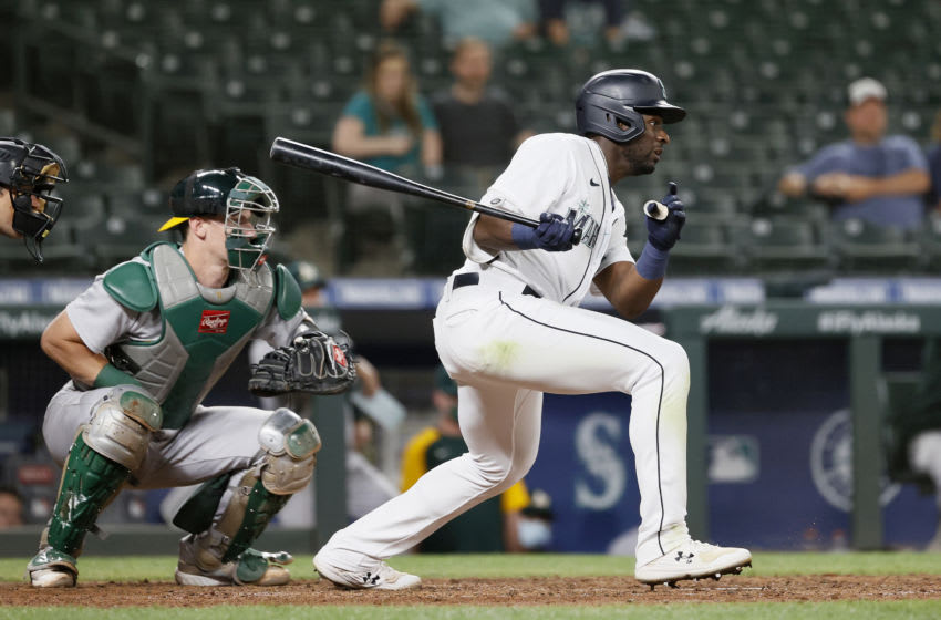 SEATTLE, WASHINGTON - JUNE 01: Taylor Trammell #20 of the Seattle Mariners at bat against the Oakland Athletics at T-Mobile Park on June 01, 2021 in Seattle, Washington. (Photo by Steph Chambers/Getty Images)