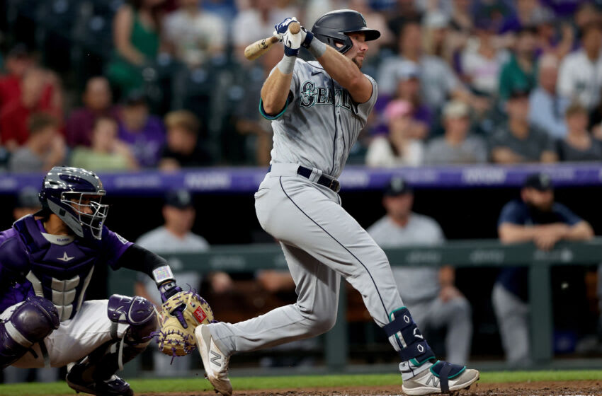 DENVER, COLORADO - JULY 20: Cal Raleigh #29 of the Seattle Mariners hits a 2 RBI home double against the Colorado Rockies in the sixth inning at Coors Field on July 20, 2021 in Denver, Colorado. (Photo by Matthew Stockman/Getty Images)