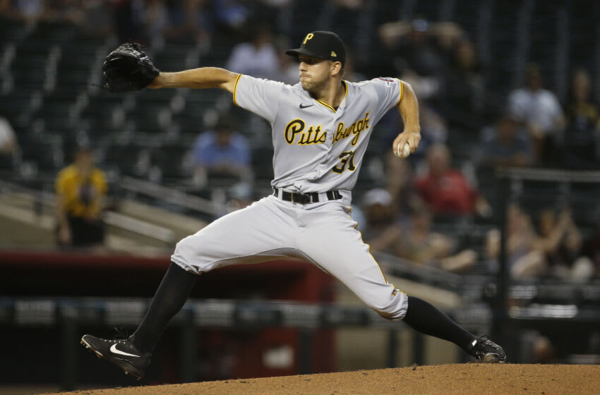PHOENIX, ARIZONA - JULY 20: Starting pitcher Tyler Anderson #31 of the Pittsburgh Pirates throws against the Arizona Diamondbacks during the second inning of the MLB game at Chase Field on July 20, 2021 in Phoenix, Arizona. (Photo by Ralph Freso/Getty Images)