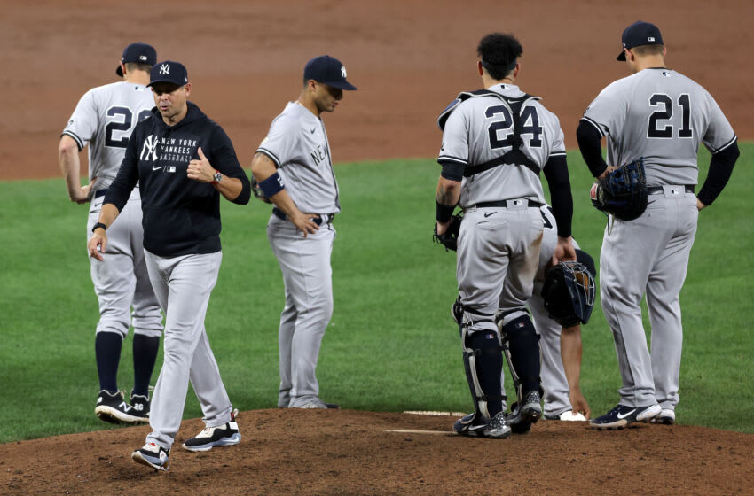 BALTIMORE, MARYLAND - SEPTEMBER 15: Manager Aaron Boone #17 of the New York Yankees walks off the mound during a pitching change against the Baltimore Oriolesat Oriole Park at Camden Yards on September 15, 2021 in Baltimore, Maryland. (Photo by Rob Carr/Getty Images)