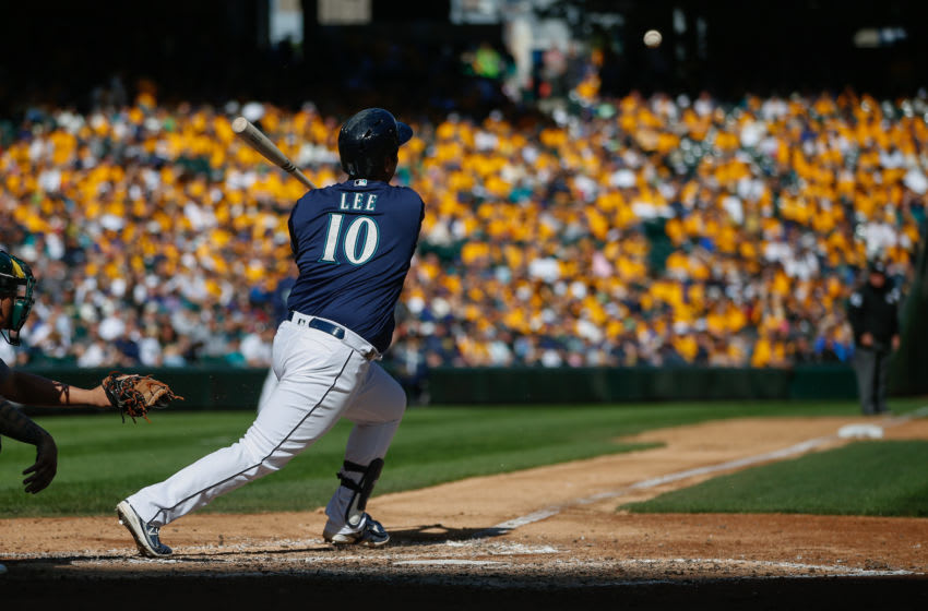 SEATTLE, WA - OCTOBER 02: Dae-Ho Lee of the Seattle Mariners singles in the fifth inning against the Oakland Athletics. (Photo by Otto Greule Jr/Getty Images)