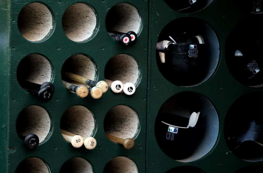 OAKLAND, CA - APRIL 06: Bats and helmets belonging to the Seattle Mariners rest in the dugout during their game against the Oakland Athletics at the Oakland-Alameda County Coliseum on April 6, 2010 in Oakland, California. (Photo by Ezra Shaw/Getty Images)
