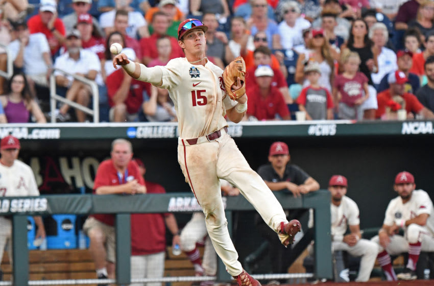 Omaha, NE - JUNE 27: Infielder Casey Martin #15 of the Arkansas Razorbacks makes a throw to first base in the fifth inning against the Oregon State Beavers during game two of the College World Series Championship Series on June 27, 2018 at TD Ameritrade Park in Omaha, Nebraska. (Photo by Peter Aiken/Getty Images)
