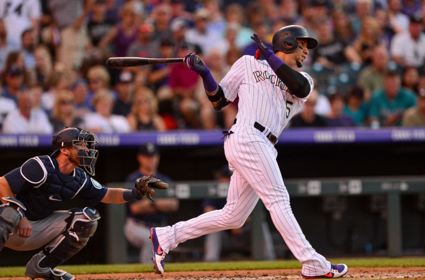 DENVER, CO - JULY 14: Carlos Gonzalez #5 of the Colorado Rockies follows through on a second inning 2-run homerun against the Seattle Mariners at Coors Field on July 14, 2018 in Denver, Colorado. (Photo by Dustin Bradford/Getty Images)