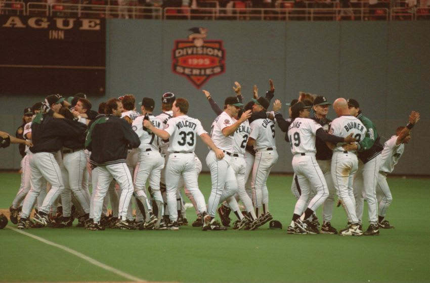 8 Oct 1995: THE SEATTLE MARINERS CELEBRATE THEIR 6-5 VICTORY OVER THE NEW YORK YANKEES IN GAME FIVE OF THE AMERICAN LEAGUE PLAYOFFS AT THE KINGDOME IN SEATTLE, WASHINGTON.