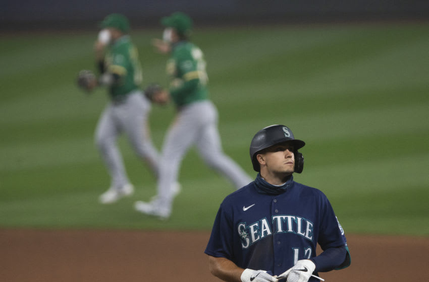 SEATTLE, WA - SEPTEMBER 14: Evan White of the Seattle Mariners stands at first base after popping out to end the game.(Photo by Lindsey Wasson/Getty Images)