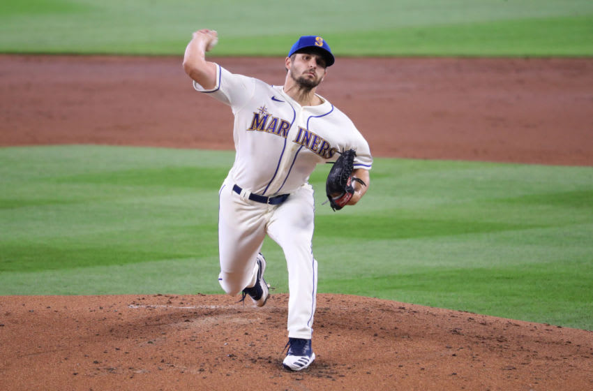 SEATTLE, WASHINGTON - AUGUST 02: Kendall Graveman of the Seattle Mariners pitches against the Oakland Athletics during their game at T-Mobile Park. (Photo by Abbie Parr/Getty Images)