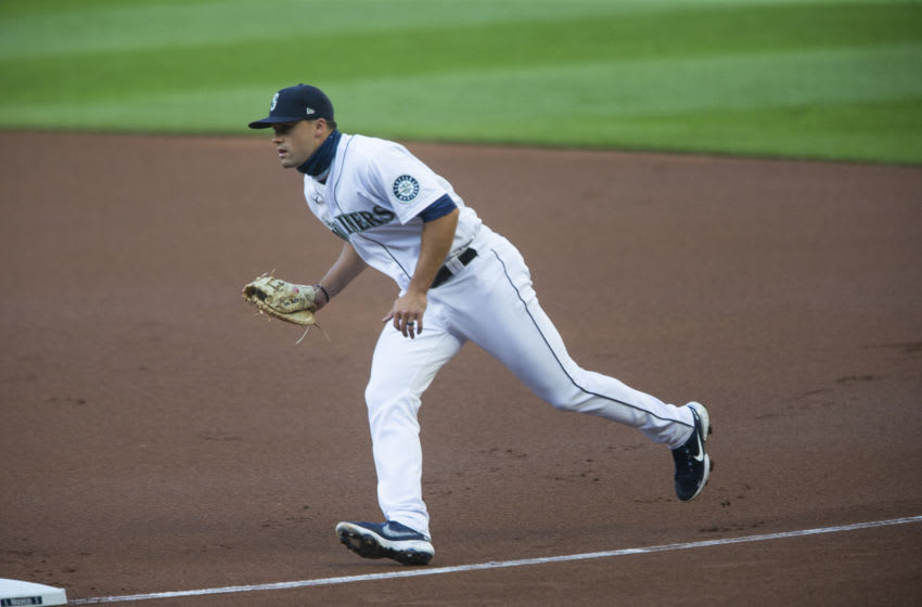 Evan White of the Seattle Mariners runs to tag first for an out. (Photo by Lindsey Wasson/Getty Images)