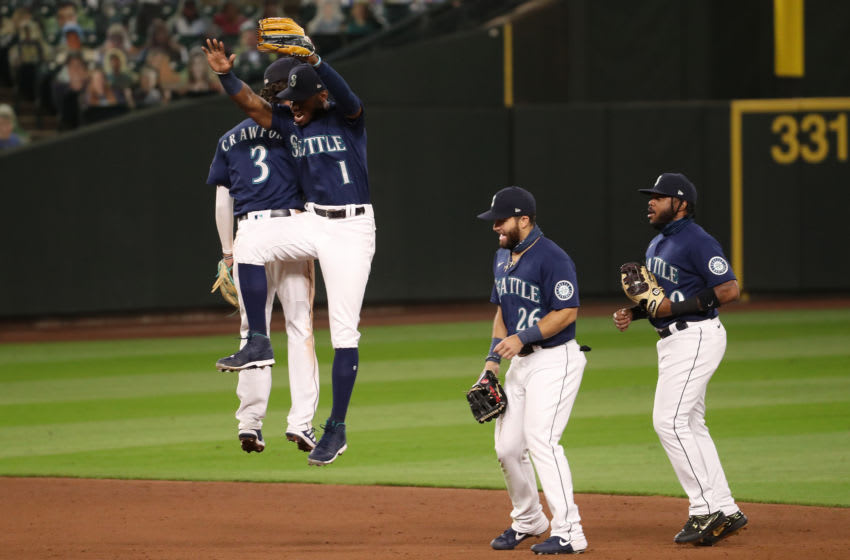 SEATTLE, WASHINGTON - SEPTEMBER 21: J.P. Crawford and Kyle Lewis of the Seattle Mariners a win against the Astros at T-Mobile Park. (Photo by Abbie Parr/Getty Images)