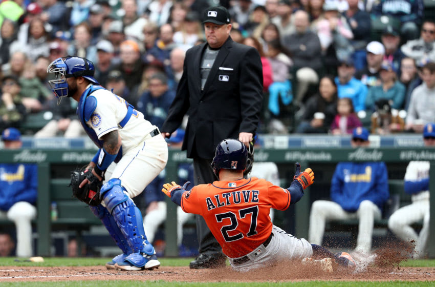 SEATTLE, WA - APRIL 14: Jose Altuve #27 of the Houston Astros scores off a RBI single by Michael Brantley #23 of the Houston Astros in the sixth inning against the Seattle Mariners during their game at T-Mobile Park on April 14, 2019 in Seattle, Washington. (Photo by Abbie Parr/Getty Images)