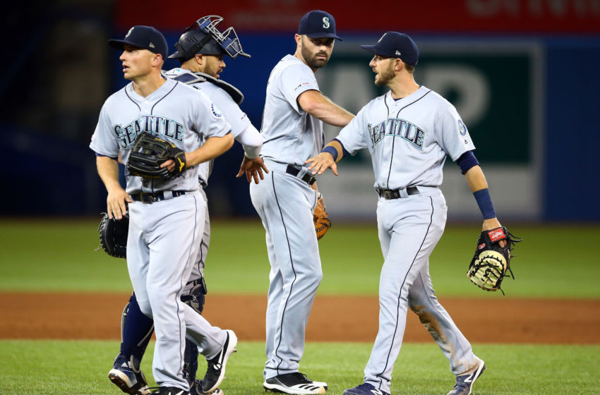 TORONTO, ON - AUGUST 17: Kyle Seager #15, Omar Navarez #22, Matt Magill #61 and Austin Nola #23 of the Seattle Mariners celebrate after defeating the Toronto Blue Jays during a MLB game at Rogers Centre on August 17, 2019 in Toronto, Canada. (Photo by Vaughn Ridley/Getty Images)