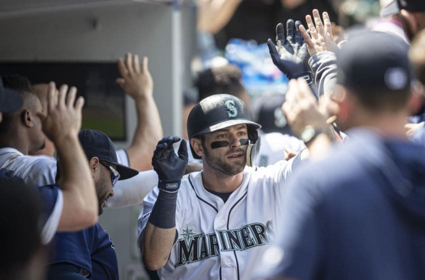 SEATTLE, WA - MAY 29: Mitch Haniger #17 of the Seattle Mariners is congratulated by teammates in the dugout after hitting a two-run home run off of starting pitcher Drew Smyly #33 of the Texas Rangers during the sixth inning of a game at T-Mobile Park on May 29, 2019 in Seattle, Washington. The Rangers won 8-7. (Photo by Stephen Brashear/Getty Images)