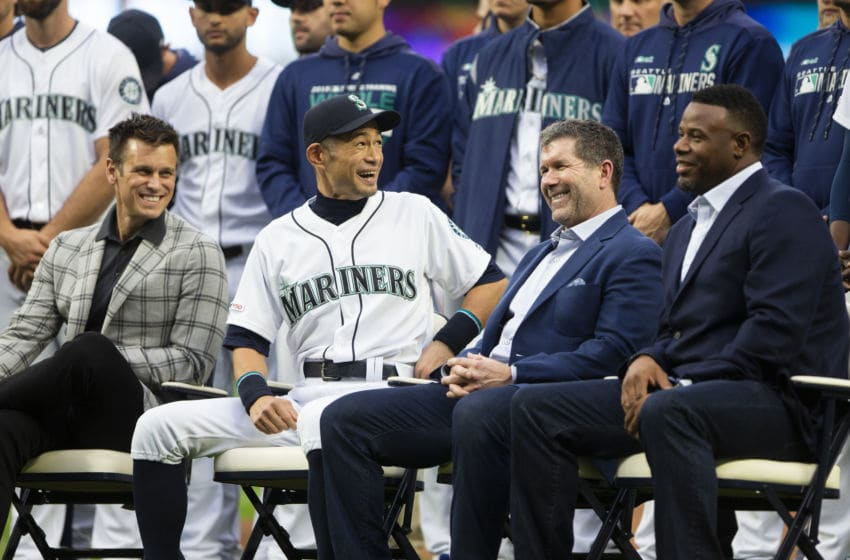 SEATTLE, WA - SEPTEMBER 14: Seattle Mariners general manager Jerry Dipoto looks on as Ichiro Suzuki, center laughs with former Seattle Mariners players Edgar Martinez and Ken Griffey Jr. as Suzuki receives the Seattle Mariners Franchise Achievement Award before the game against the Chicago White Sox at T-Mobile Park on September 14, 2019 in Seattle, Washington. (Photo by Lindsey Wasson/Getty Images)