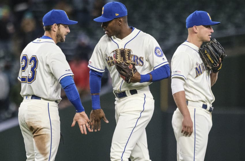 SEATTLE, WA - SEPTEMBER 29: (L-R) Austin Nola #23 of the Seattle Mariners, Kyle Lewis #30 and Kyle Seager #15 of the Seattle Mariners celebrates after a game against the Oakland Athletics at T-Mobile Park on September 29, 2019 in Seattle, Washington. The Mariners won 3-1/ (Photo by Stephen Brashear/Getty Images)