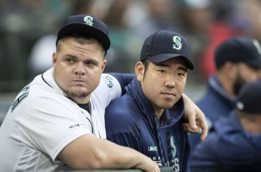 SEATTLE, WA - SEPTEMBER 28: Yusei Kikuchi #18 (R) of the Seattle Mariners stands next to Daniel Vogelbach #20 at the top of the dugout brefore a game against the Oakland Athletics at T-Mobile Park on September 28, 2019 in Seattle, Washington. (Photo by Stephen Brashear/Getty Images)