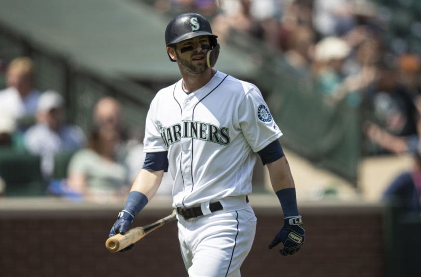 Mariners' Mitch Haniger walks back to the dugout while carrying his bat. (Photo by Stephen Brashear/Getty Images)