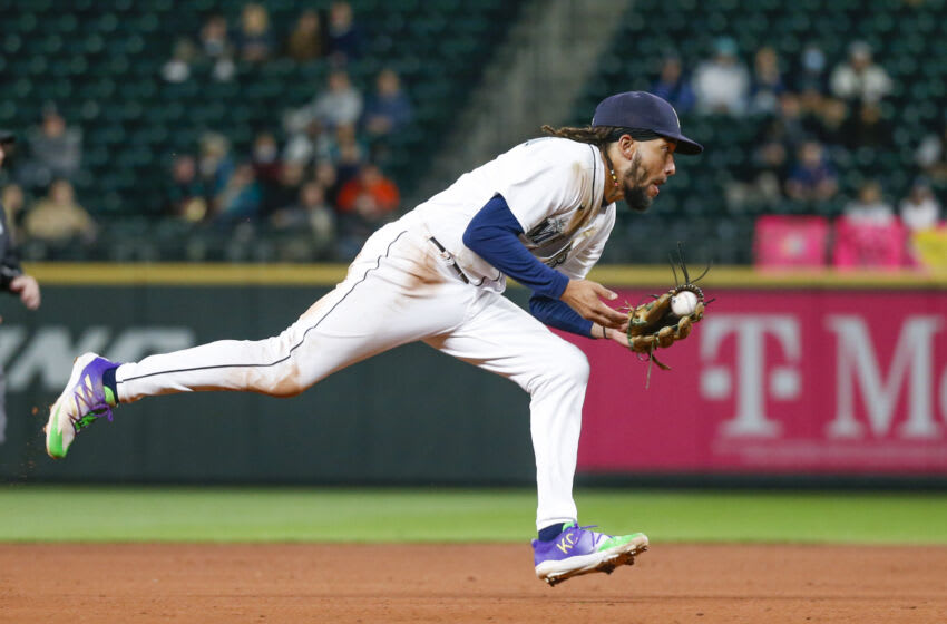 Aug 30, 2021; Seattle, Washington, USA; Seattle Mariners shortstop J.P. Crawford (3) fields a ground ball against the Houston Astros during the eighth inning at T-Mobile Park. Mandatory Credit: Joe Nicholson-USA TODAY Sports