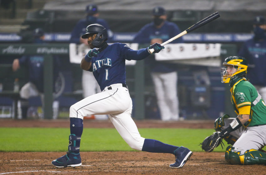 Sep 14, 2020; Seattle, Washington, USA; Seattle Mariners center fielder Kyle Lewis (1) hits a double against the Oakland Athletics during the seventh inning at T-Mobile Park. Mandatory Credit: Joe Nicholson-USA TODAY Sports