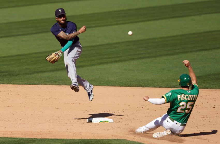 Sep 26, 2020; Oakland, California, USA; Seattle Mariners Gold Glove shortstop J.P. Crawford throws the ball to first base. Mandatory Credit: Darren Yamashita-USA TODAY Sports