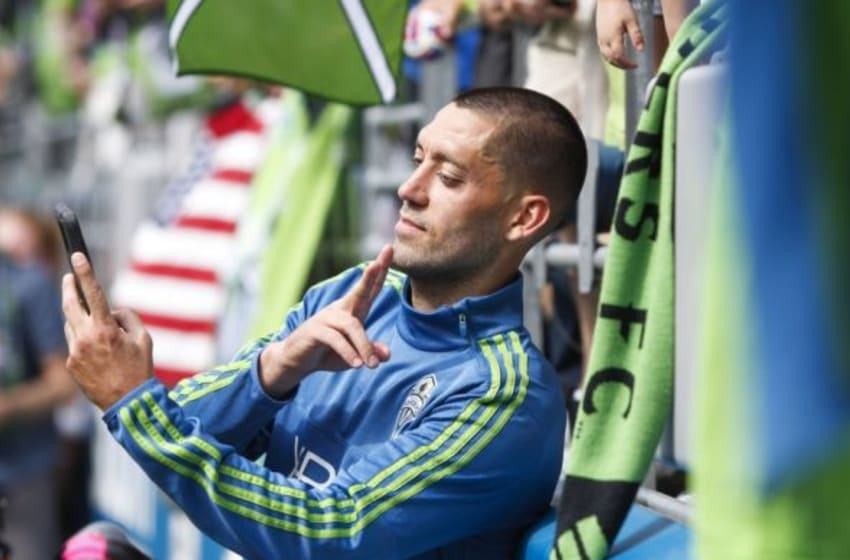 May 31, 2015; Seattle, WA, USA; Seattle Sounders FC forward Clint Dempsey (2) poses for a selfie with a fan following a 2-1 victory against the New York Red Bulls during the second half at CenturyLink Field. Mandatory Credit: Joe Nicholson-USA TODAY Sports