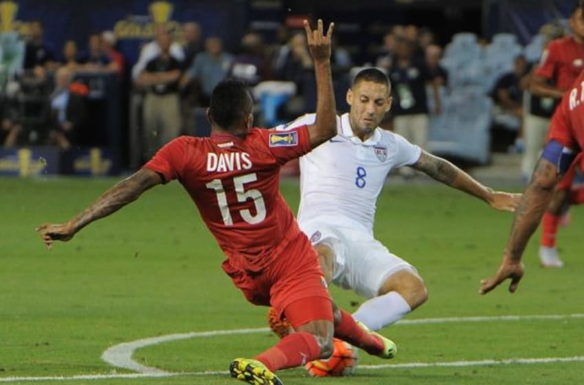 Jul 13, 2015; Kansas City, MO, USA; USA forward Clint Dempsey (8) kicks the ball as Panama defender Erick Davis (15) defends in the second half during CONCACAF Gold Cup group play at Sporting Park. The game ended in a 1-1 tie. Mandatory Credit: John Rieger-USA TODAY Sports