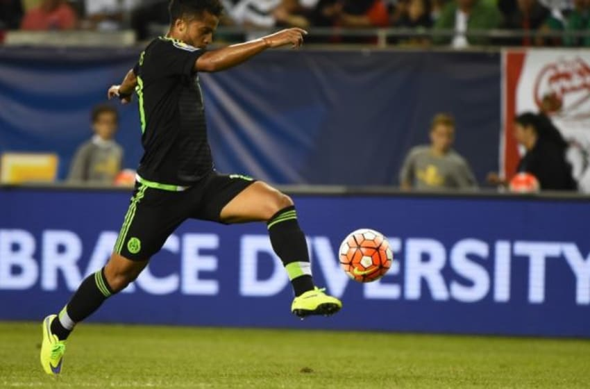 Jul 9, 2015; Chicago, IL, USA; Mexico midfielder Giovani Dos Santos (10) scores a goal against Cuba in the second half during CONCACAF Gold Cup group play at Soldier Field. Mexico defeats Cuba 6-0. Mandatory Credit: Mike DiNovo-USA TODAY Sports