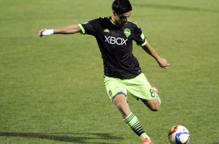 Feb 18, 2015; Tucson, AZ, USA; Seattle Sounders FC midfielder Gonzalo Pineda (8) shoots the ball during the first half against FC Tucson at Kino Sports Complex. Mandatory Credit: Casey Sapio-USA TODAY Sports
