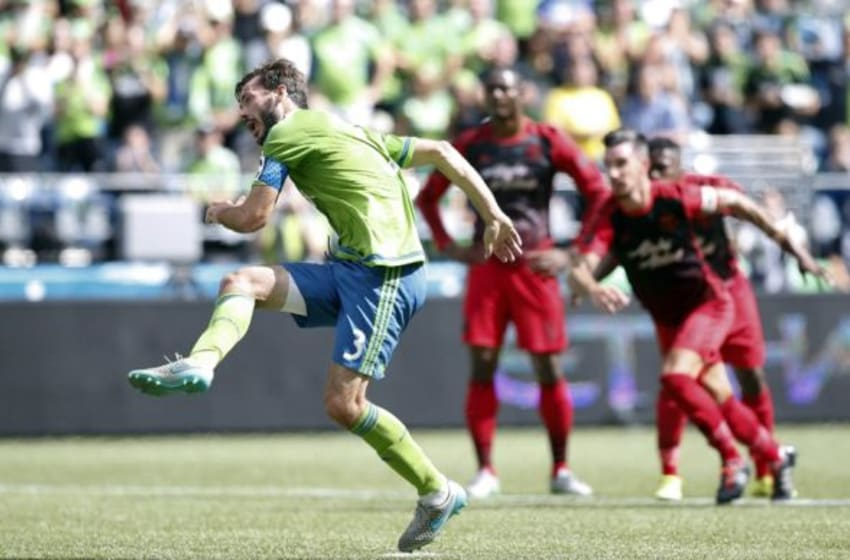 Aug 30, 2015; Seattle, WA, USA; Seattle Sounders FC midfielder Brad Evans (3) shoots a penalty kick for a goal against the Portland Timbers during the first half at CenturyLink Field. Mandatory Credit: Joe Nicholson-USA TODAY Sports