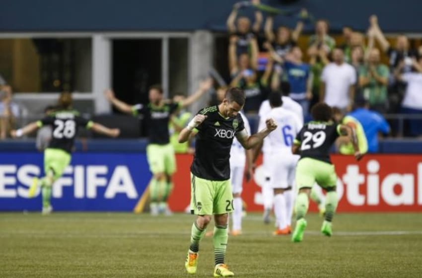 Aug 19, 2015; Seattle, WA, USA; Seattle Sounders FC defender Zach Scott (20) reacts to a tie-breaking goal scored against CD Olimpia late during the second half at CenturyLink Field. Seattle defeated Olimpia, 2-1. Mandatory Credit: Joe Nicholson-USA TODAY Sports