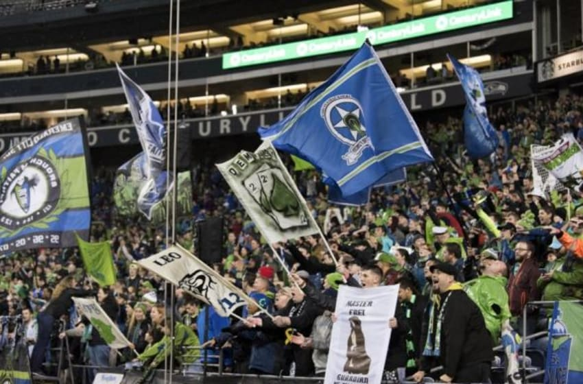 Oct 28, 2015; Seattle, WA, USA; Seattle Sounders FC fans celebrate after the Seattle Sounders FC defeated the Los Angeles Galaxy at CenturyLink Field. Seattle defeated Los Angeles 3-2. Mandatory Credit: Steven Bisig-USA TODAY Sports