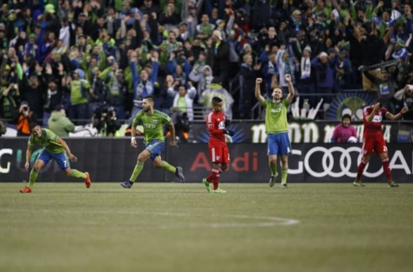 Nov 1, 2015; Seattle, WA, USA; (From left to right) Seattle Sounders FC midfielder Cristian Roldan (7), forward Clint Dempsey (2), FC Dallas midfielder Michael Barrios (21), defender Chad Marshall (14) and defender Matt Hedges (24) react to Dempsey