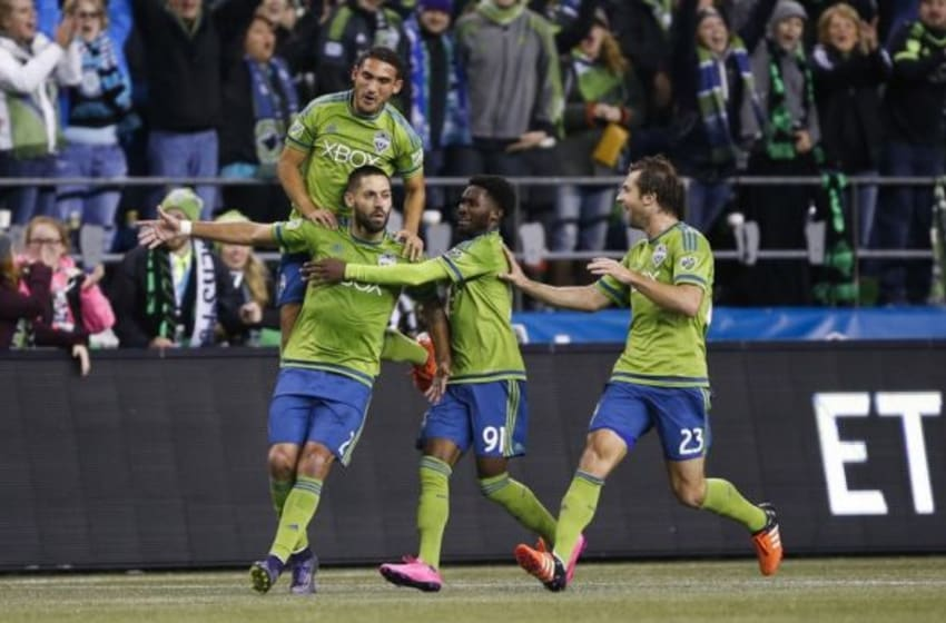 Nov 1, 2015; Seattle, WA, USA; Seattle Sounders FC midfielder Cristian Roldan (7), midfielder Oniel Fisher (91) and midfielder Andreas Ivanschitz (23) celebrate with forward Clint Dempsey (2) after Dempsey scored during the second half against FC Dallas at CenturyLink Field. Mandatory Credit: Jennifer Buchanan-USA TODAY Sports