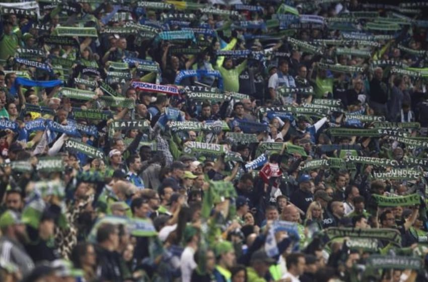 Oct 4, 2015; Seattle, WA, USA; Seattle Sounders FC fans hold up their scarves from the stands prior to the match against the Los Angeles Galaxy at CenturyLink Field. Los Angeles tied Seattle, 1-1. Mandatory Credit: Joe Nicholson-USA TODAY Sports