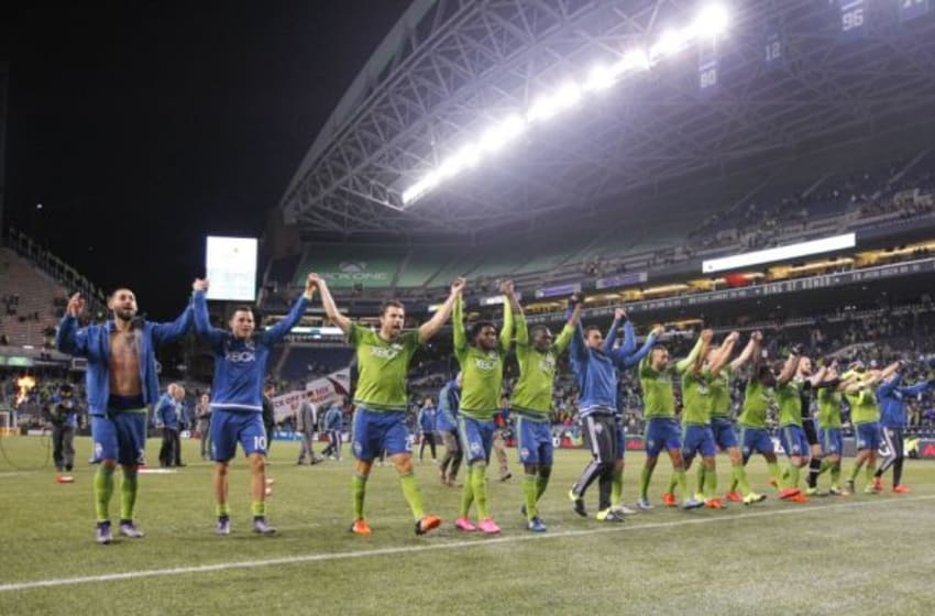 Nov 1, 2015; Seattle, WA, USA; Seattle Sounders FC players take a bow to the fans following a 2-1 victory against the FC Dallas at CenturyLink Field. Mandatory Credit: Joe Nicholson-USA TODAY Sports