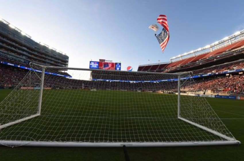 August 2, 2014; Santa Clara, CA, USA; A parachuter carries the American flag before the match between the San Jose Earthquakes and the Seattle Sounders FC at Levi