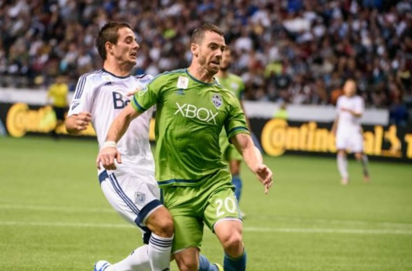 Sep 19, 2015; Vancouver, British Columbia, CAN; Vancouver Whitecaps forward Octavio Rivero (29) battles for the ball against Seattle Sounders defender Zach Scott (20) during the second half at BC Place. The Seattle Sounders won 3-0. Mandatory Credit: Anne-Marie Sorvin-USA TODAY Sports