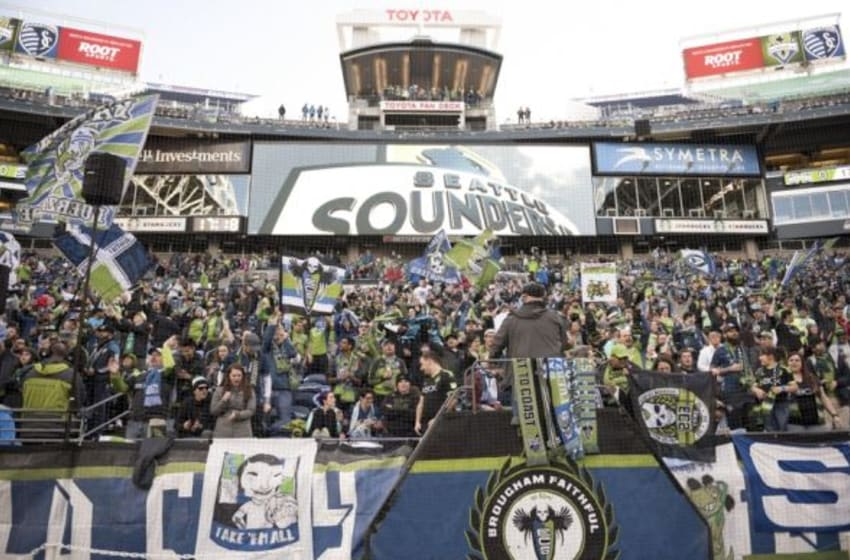 Mar 6, 2016; Seattle, WA, USA; Seattle Sounders soccer fans sing songs before the start of a game against Sporting KC at CenturyLink Field. Mandatory Credit: Troy Wayrynen-USA TODAY Sports