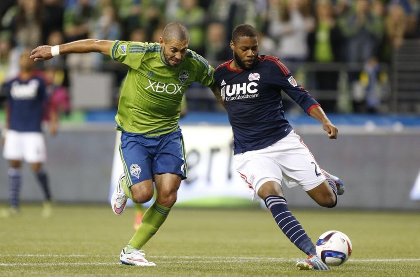 Mar 8, 2015; Seattle, WA, USA; Seattle Sounders FC forward Clint Dempsey (2) vies for the ball with New England Revolution defender Andrew Farrell (2) during the second half at CenturyLink Field. Seattle defeated New England 3-0. Mandatory Credit: Jennifer Buchanan-USA TODAY Sports