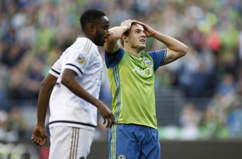 Apr 16, 2016; Seattle, WA, USA; Seattle Sounders forward Jordan Morris (13) reacts after missing a shot against the Philadelphia Union during the first half at CenturyLink Field. Mandatory Credit: Jennifer Buchanan-USA TODAY Sports