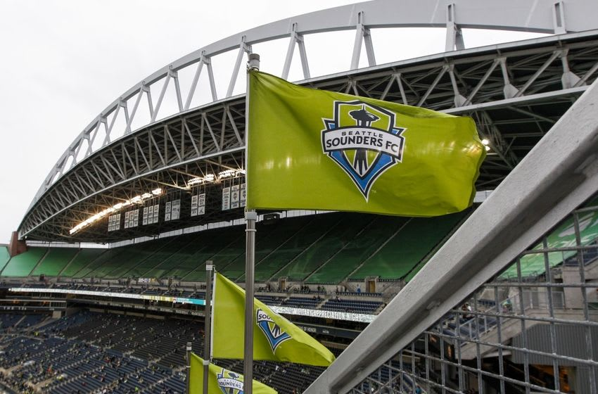 May 21, 2016; Seattle, WA, USA; Seattle Sounders flags fly in the wind before the start of a game against the Colorado Rapids at CenturyLink Field. Mandatory Credit: Jennifer Buchanan-USA TODAY Sports