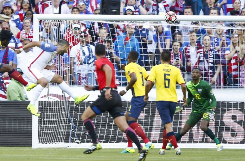 Jun 16, 2016; Seattle, WA, USA; United States forward Clint Dempsey (8) heads in a goal against Ecuador goalkeeper Alexander Dominguez (22) during the first half of quarter-final play in the 2016 Copa America Centenario soccer tournament at Century Link Field. Mandatory Credit: Joe Nicholson-USA TODAY Sports