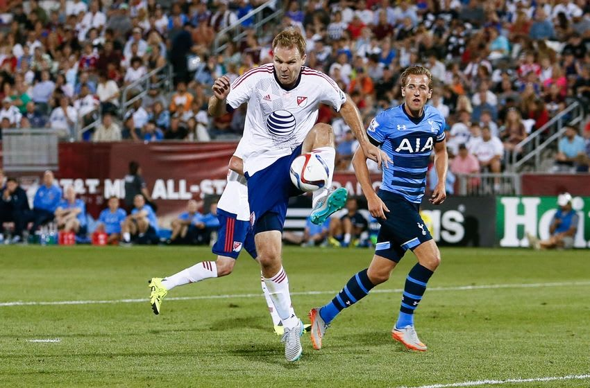 Jul 29, 2015; Denver, CO, USA; MLS All Stars defender Chad Marshall (14) of Seattle Sounders FC fields the ball in front of Tottenham Hotspur forward Harry Kane (18) in the second half of the 2015 MLS All Star Game at Dick