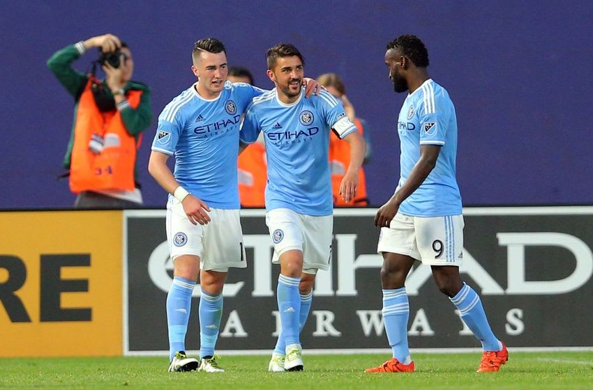 Jun 2, 2016; New York, NY, USA; New York City FC midfielder Jack Harrison (11) celebrates his goal against Real Salt Lake with New York City FC forward David Villa (7) and New York City FC forward Steven Mendoza (9) during the second half at Yankee Stadium. Real Salt Lake defeated New York City 3-2. Mandatory Credit: Brad Penner-USA TODAY Sports