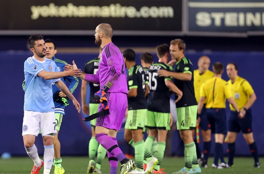 May 3, 2015; New York, NY, USA; New York City FC forward David Villa (7) shakes hands with Seattle Sounders FC goalkeeper Stefan Frei (24) after their soccer game at Yankee Stadium. The Sounders FC defeated the New York City FC 3 - 1. Mandatory Credit: Adam Hunger-USA TODAY Sports