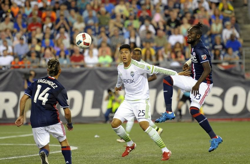 May 28, 2016; Foxborough, MA, USA; New England Revolution forward Diego Fagundez (14) Seattle Sounders defender Tony Alfaro (25) and New England Revolution Kei Kamara watch the ball during the second half at Gillette Stadium. Mandatory Credit: Bob DeChiara-USA TODAY Sports