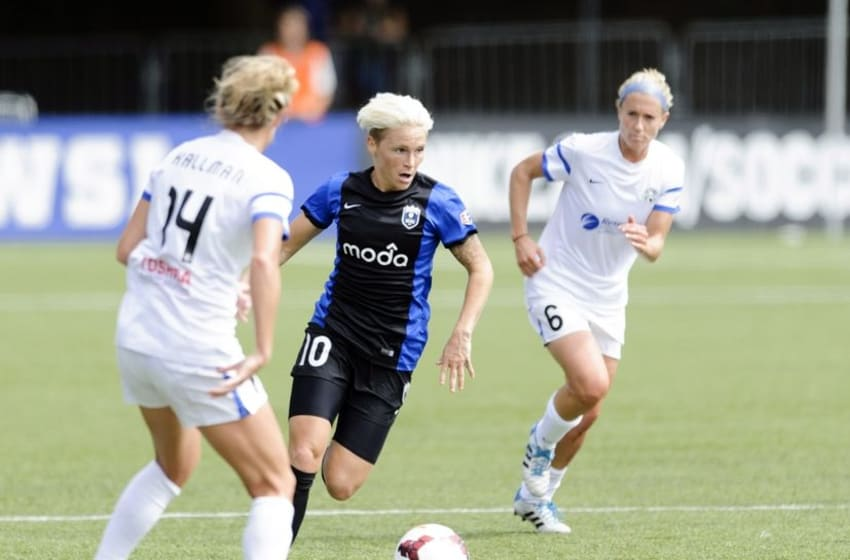 Seattle Reign FC midfielder Jessica Fishlock (10) dribbles the ball while being defended by FC Kansas City defender Kassey Kallman (14) during the game at Starfire Soccer Stadium. Kansas City defeated Seattle 2-1. Mandatory Credit: Steven Bisig-USA TODAY Sports