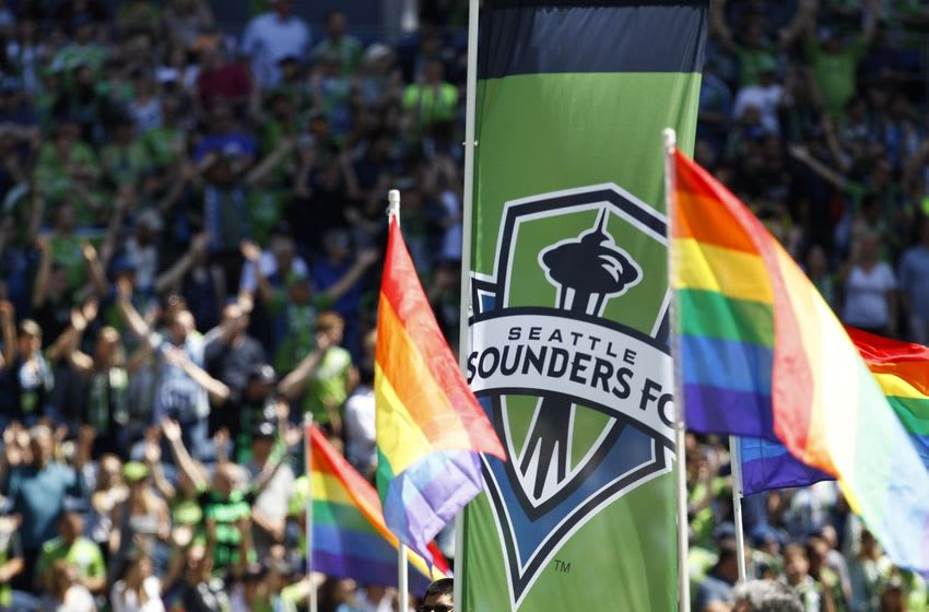 Jun 20, 2015; Seattle, WA, USA; Seattle Sounders FC banners fly during Pride Day before the start of a game against the San Jose Earthquakes at CenturyLink Field. San Jose won 2-0. Mandatory Credit: Jennifer Buchanan-USA TODAY Sports