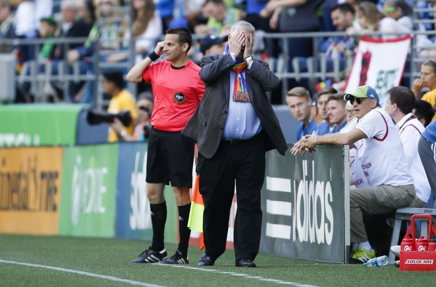 Jun 25, 2016; Seattle, WA, USA; Seattle Sounders head coach Sigi Schmid reacts after a goal by New York City FC midfielder Frank Lampard (8) during the first half at CenturyLink Field. Mandatory Credit: Jennifer Buchanan-USA TODAY Sports