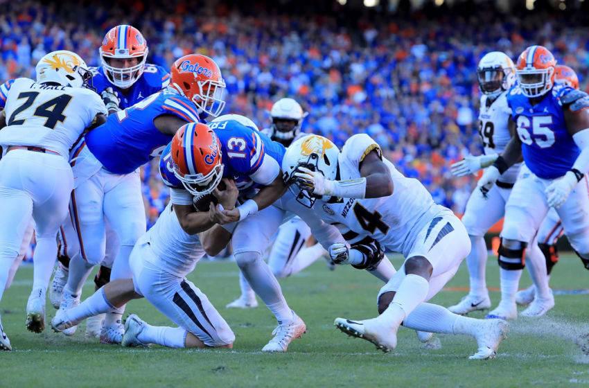 Feleipe Franks #13 of the Florida football Gators rushes for yardage. (Photo by Sam Greenwood/Getty Images)
