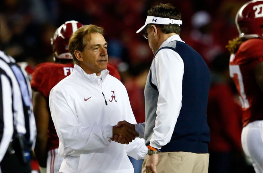 TUSCALOOSA, AL - NOVEMBER 29: (L-R) Head coach Nick Saban of the Alabama Crimson Tide shakes hands with head coach Gus Malzahn of the Auburn Tigers on the field prior to the Iron Bowl at Bryant-Denny Stadium on November 29, 2014 in Tuscaloosa, Alabama. (Photo by Kevin C. Cox/Getty Images)